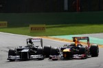 Bruno Senna, Williams and Sebastian Vettel, Red Bull Racing battle for position