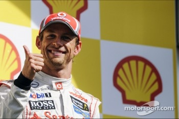 Race winner Jenson Button, McLaren celebrates on the podium