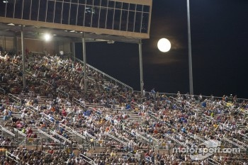 The moon rises over the race