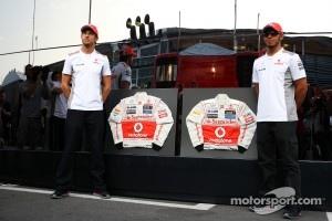 Jenson Button, McLaren and Lewis Hamilton, McLaren sign their race overalls