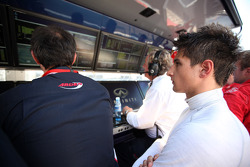Mitch Evans watches from the pits after retiring