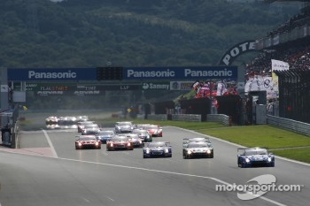 GT500 start: #12 Team Impul Nissan GT-R: Joao Paulo de Oliveira, Tsugio Matsuda leads the field
