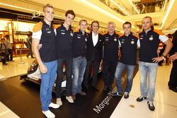 Jacques Nicolet with Emerson Fittipaldi and drivers