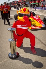 Firestone Firehawk poses with the Indy Lights series Firehawk trophy