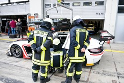 Pitlane Firemen inspect the All-Inkl Mercedes SLS