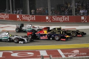 Romain Grosjean, Lotus F1 leads Mark Webber, Red Bull Racing