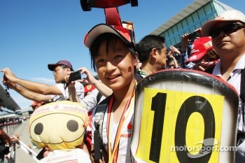 A McLaren fan at the pit lane walkabout