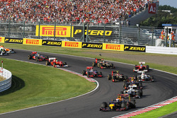 Sebastian Vettel, Red Bull Racing leads at the start of the race as Fernando Alonso, Ferrari crashes out after contact with Kimi Raikkonen, Lotus F1