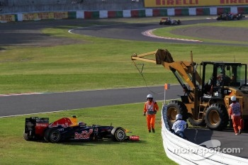 Mark Webber, Red Bull Racing runs off the track and stops at the start of the race before restarting