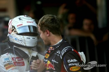 Kamui Kobayashi, Sauber F1 Team and Sebastian Vettel, Red Bull Racing