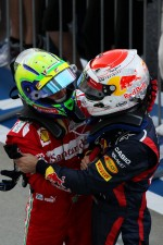 Felipe Massa, Ferrari celebrates his second position in parc ferme with race winner Sebastian Vettel, Red Bull Racing