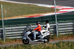 Sergio Perez, Sauber rides back to the pits on a scooter after stopping in the second practice session