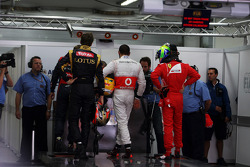 Romain Grosjean, Lotus F1 Team; Lewis Hamilton, McLaren and Felipe Massa, Ferrari in parc ferme