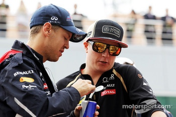 Sebastian Vettel, Red Bull Racing with Kimi Raikkonen, Lotus F1 Team on the drivers parade