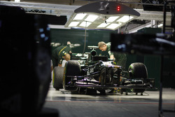 Caterham CT01 in the pit garage at night