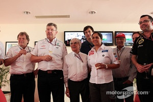 Bernie Ecclestone, CEO Formula One Group, celebrates his 82nd birthday with team personnel.