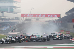 Michael Schumacher, Mercedes AMG F1 and Jean-Eric Vergne, Scuderia Toro Rosso make contact at the start of the race