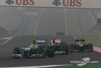 Nico Rosberg, Mercedes AMG F1 leads Pastor Maldonado, Williams