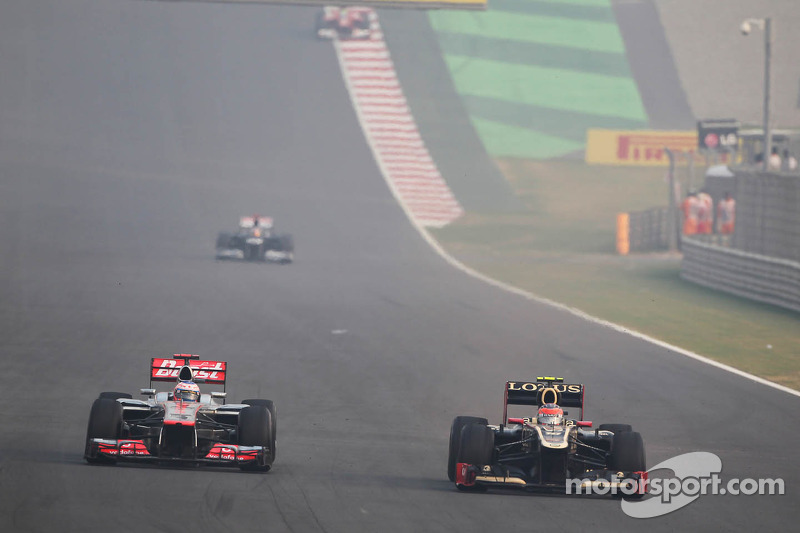 Romain Grosjean, Lotus F1 and Jenson Button, McLaren