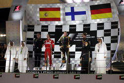 The podium: second place Fernando Alonso, Ferrari, race winner Kimi Raikkonen, Lotus F1 Team, third place Sebastian Vettel, Red Bull Racing