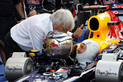 Sebastian Vettel, Red Bull Racing waits to start his race from the pit lane and talks with Bernie Ecclestone, CEO Formula One Group (FOM)