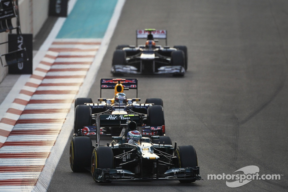 Romain Grosjean, Lotus F1 leads Sebastian Vettel, Red Bull Racing