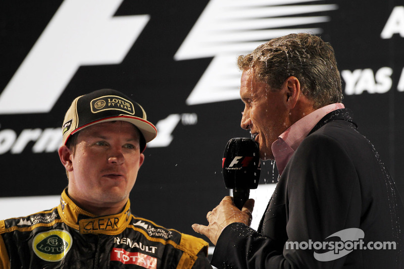 David Coulthard, Red Bull Racing and Scuderia Toro Advisor / BBC Television Commentator with Kimi Raikkonen, Lotus F1 Team on the podium