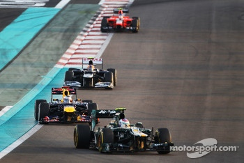 Vitaly Petrov, Caterham leads Sebastian Vettel, Red Bull Racing