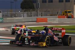 Daniel Ricciardo, Scuderia Toro Rosso leads Sebastian Vettel, Red Bull Racing