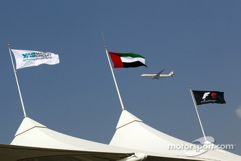 Etihad plane flies past the grandstand flags