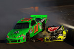 Danica Patrick is hit by Paul Menard at the finish