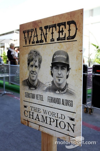 Wild West style sign for championship contenders Sebastian Vettel, Red Bull Racing and Fernando Alonso, Ferrari