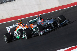 Michael Schumacher, Mercedes AMG F1 W03 leads Nico Hulkenberg, Sahara Force India F1 VJM05