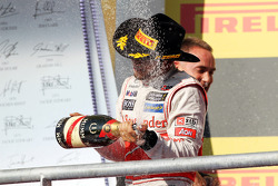 Race winner Lewis Hamilton, McLaren celebrates on the podium