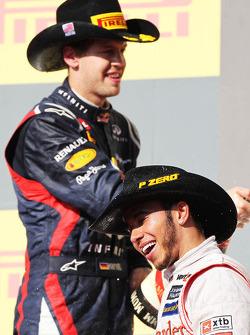 Race winner Lewis Hamilton, McLaren celebrates on the podium with Sebastian Vettel, Red Bull Racing