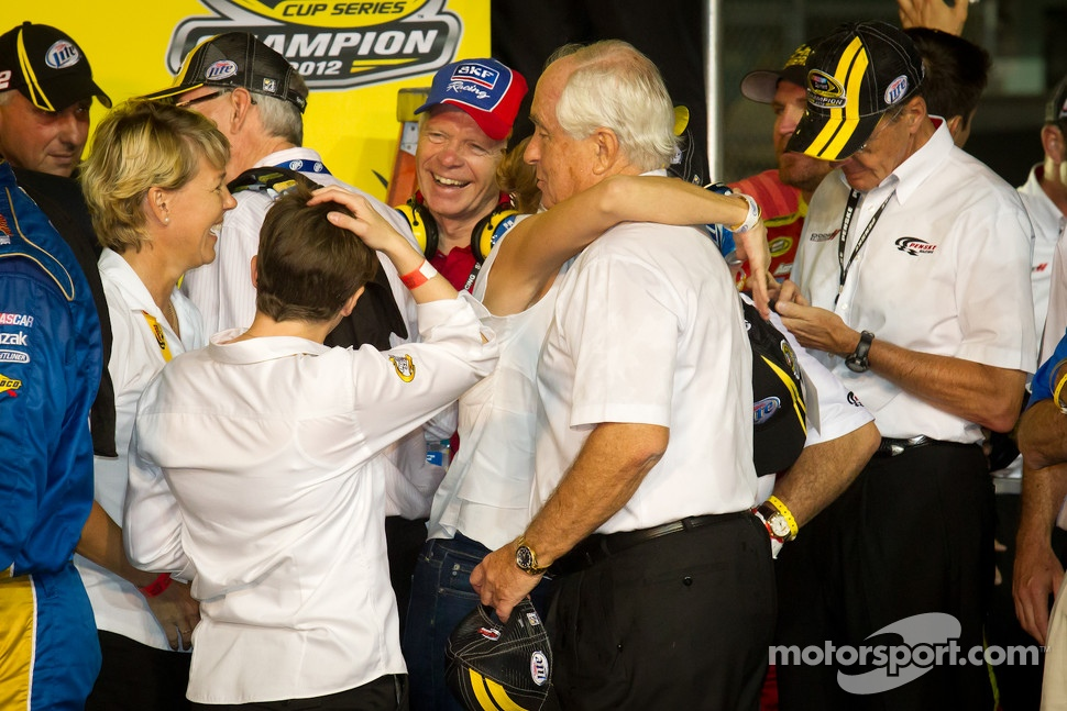 Championship victory lane: Roger Penske realizes that he was wearing a Hendrick Motorsports hat