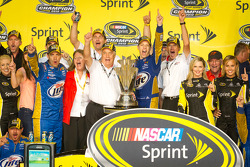 Championship victory lane: 2012 NASCAR Sprint Cup Series champion Brad Keselowski, Penske Racing Dodge celebrates with Roger Penske and his team
