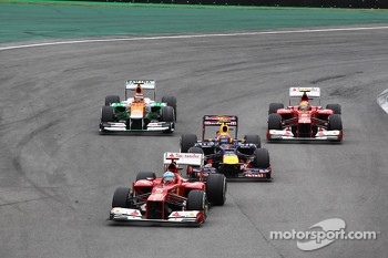 Fernando Alonso, Ferrari leads Mark Webber, Red Bull Racing