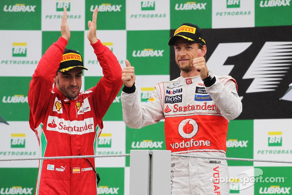 Podium: race winner Jenson Button, McLaren Mercedes, second place Fernando Alonso, Ferrari