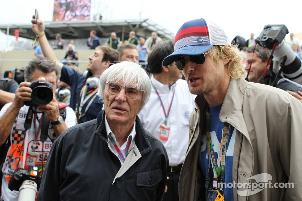 Bernie Ecclestone, CEO Formula One Group, with Owen Wilson, on the grid