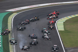 Sebastian Vettel, Red Bull Racing survives a crash with Bruno Senna, Williams and Sergio Perez, Sauber at the start of the race