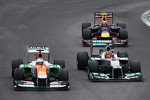Paul di Resta, Sahara Force India and Michael Schumacher, Mercedes AMG F1