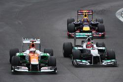 Paul di Resta, Sahara Force India and Michael Schumacher, Mercedes AMG F1