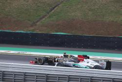 Michael Schumacher, Mercedes AMG F1 and Kimi Raikkonen, Lotus F1 battle for position