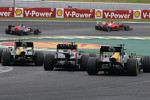 Mark Webber, Red Bull Racing and Vitaly Petrov, Caterham F1 Team