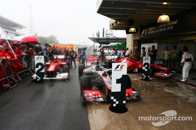The cars in parc ferme, Fernando Alonso, Ferrari, second; Jenson Button, McLaren, race winner; Felipe Massa, Ferrari, third