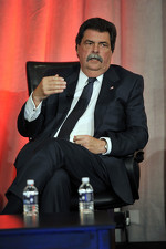 NASCAR President, Mike Helton speaks onstage at the NASCAR Motorsports Forum