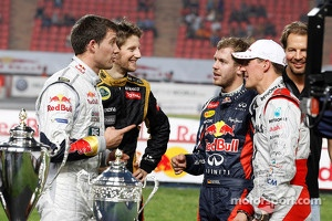 Second place Sébastien Ogier and Romain Grosjean congratulate first place Sebastian Vettel and Michael Schumacher