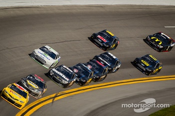 Kyle Busch, Joe Gibbs Racing Toyota and Martin Truex Jr., Michael Waltrip Racing Toyota lead a group of cars
