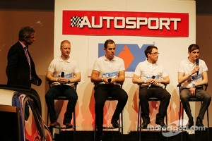 KX Academy driver Sam Tordoff on far right speaking on the microphone